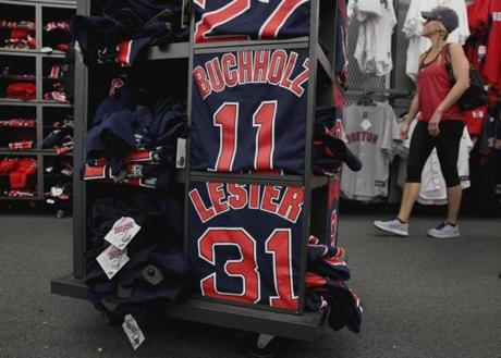 Fans can buy T-shirts of current Red Sox pitcher Clay Buchholz as well as former ace Jon Lester at the Yawkey Way Store.